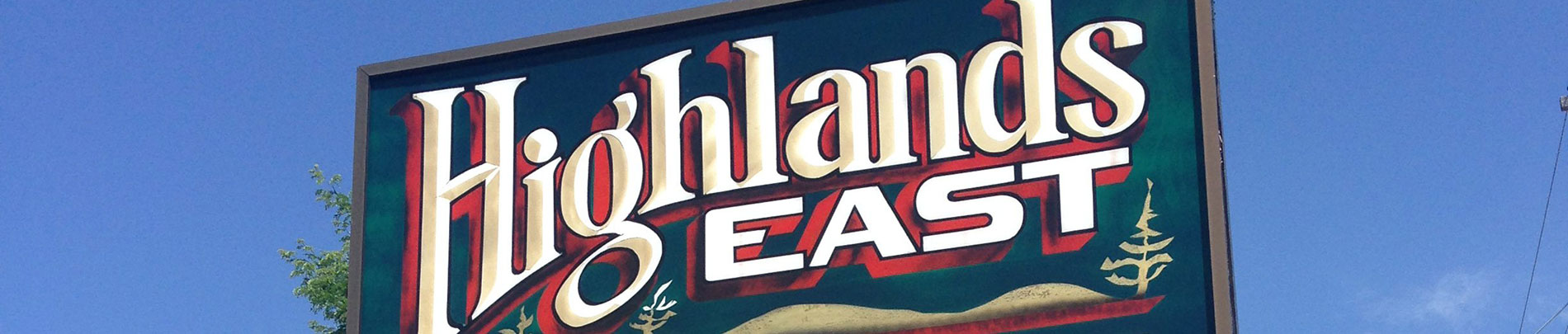 A close up of the sign in front of the municipal office that reads Highlands East.