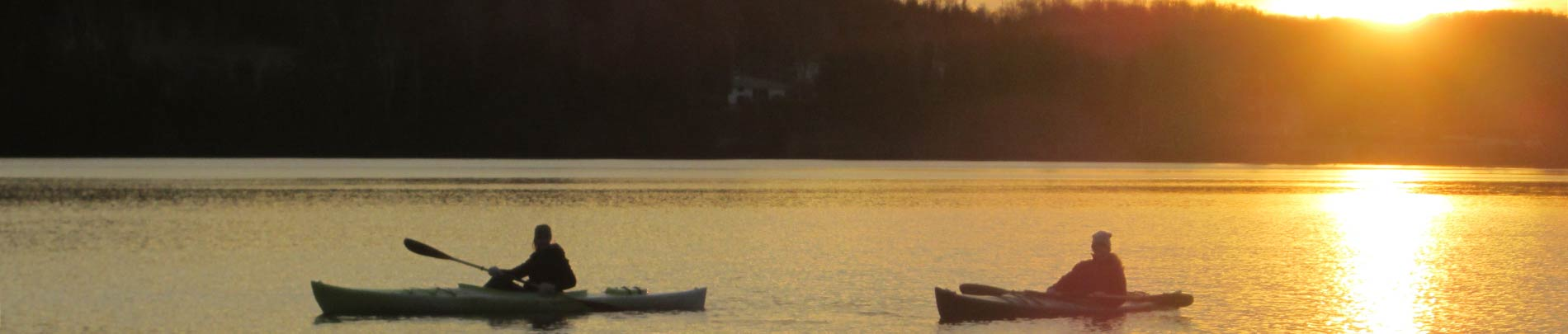 Canoes on Wilbermere Lake at sunset.