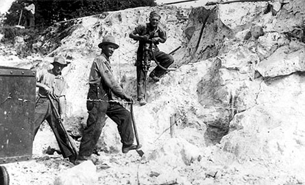 An old black and white photo of miners.