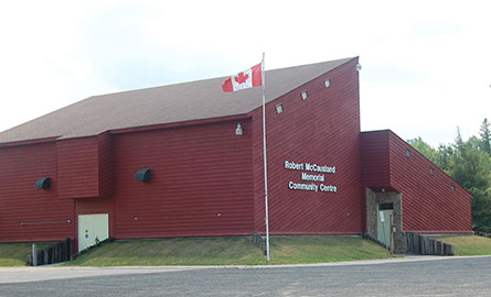 Canada flag flying in front of the Robert McCausland Memorial Community Centre in Gooderham.