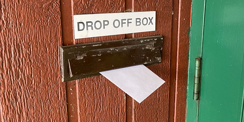 An envelope being put into the drop off slot at the Wilberforce Municipal Office..