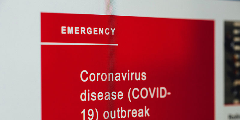 A red COVID-19 Emergency sign