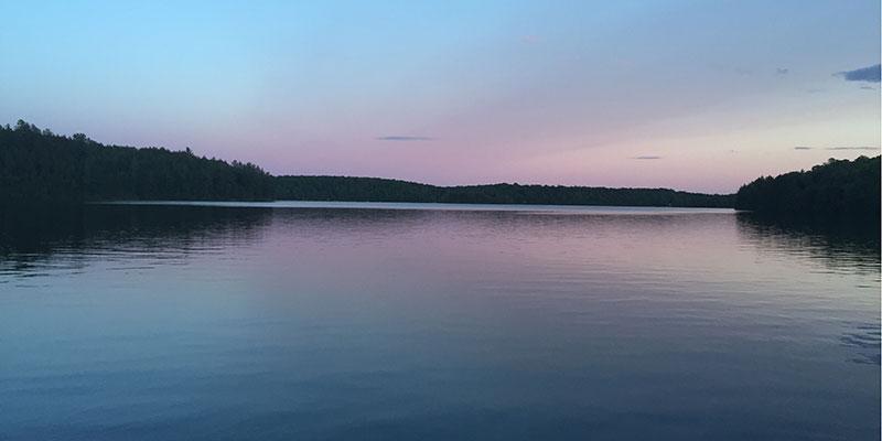 The sun sets on Glamor Lake. Photo taken by Sarah Webster.