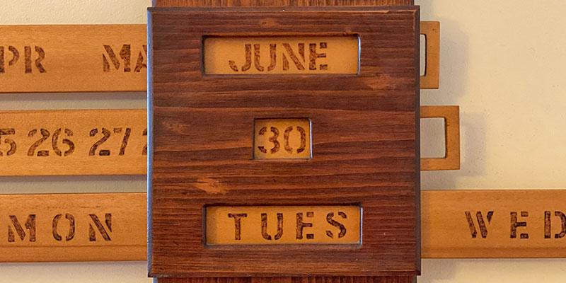 A wooden calendar shows the date June 30