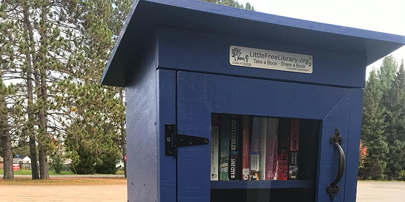 The blue box in Cardiff with glass door and books inside.