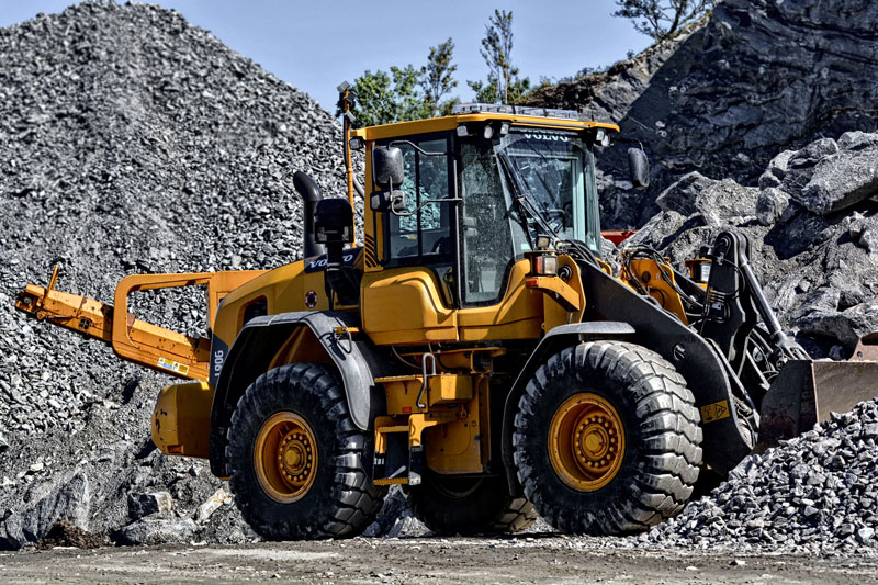 Wheel loader in a quarry moving gravel.