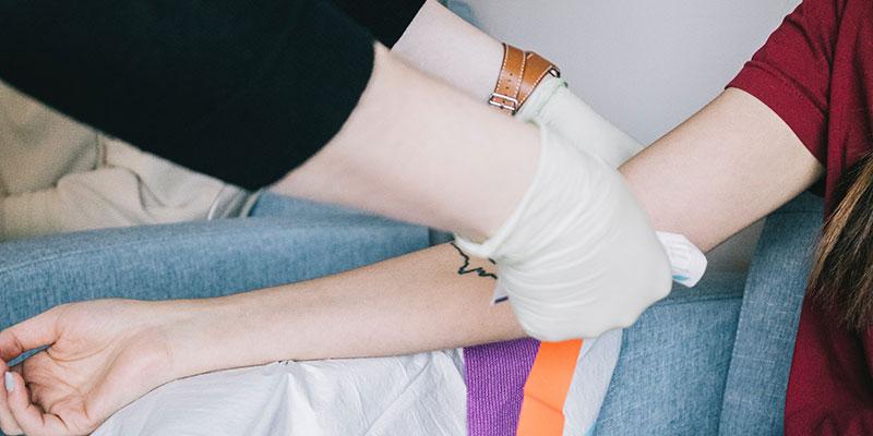 A nurse prepares a patient for testing.