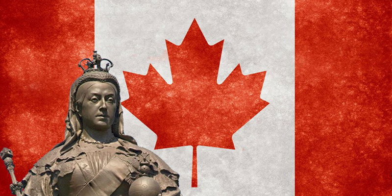 A bust of Queen Victoria stands in front of the Canadian flag.