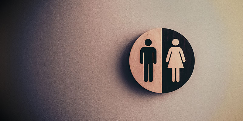 A washroom sign showing symbols for all people.